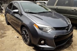 Foreign Used 2015 Grey Toyota Corolla for sale in Lagos.