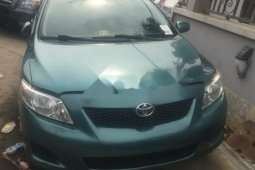 Foreign Used 2010 Green Toyota Corolla for sale in Lagos.