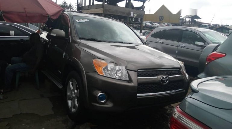 Foreign Used 2010 Gold Toyota RAV4 for sale in Lagos.-1