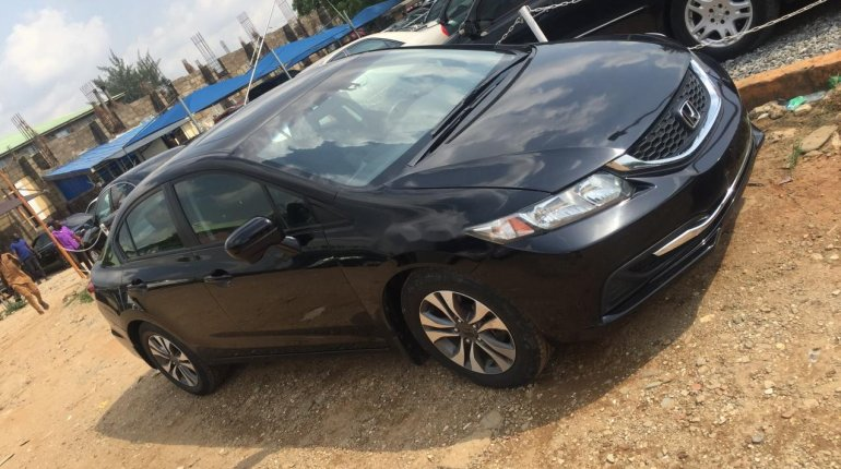 Foreign Used 2013 Black Honda Civic for sale in Abuja. -2