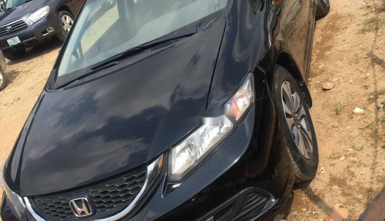 Foreign Used 2013 Black Honda Civic for sale in Abuja. -3