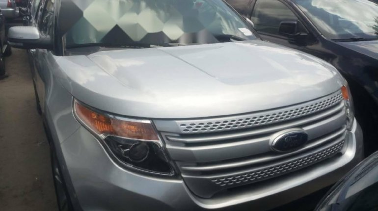 Foreign Used 2013 Silver Ford Explorer for sale in Lagos.