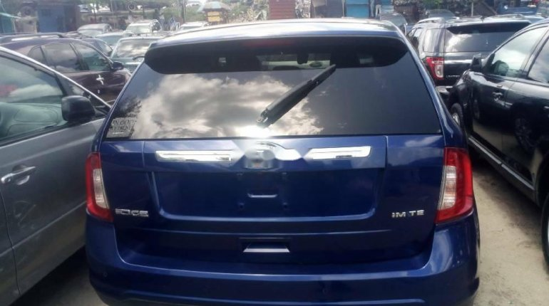 Foreign Used 2013 Blue Ford Edge for sale in Lagos. -6