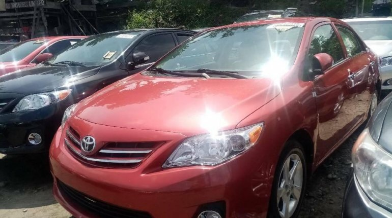 Foreign Used 2010 Red Toyota Corolla for sale in Lagos. -4