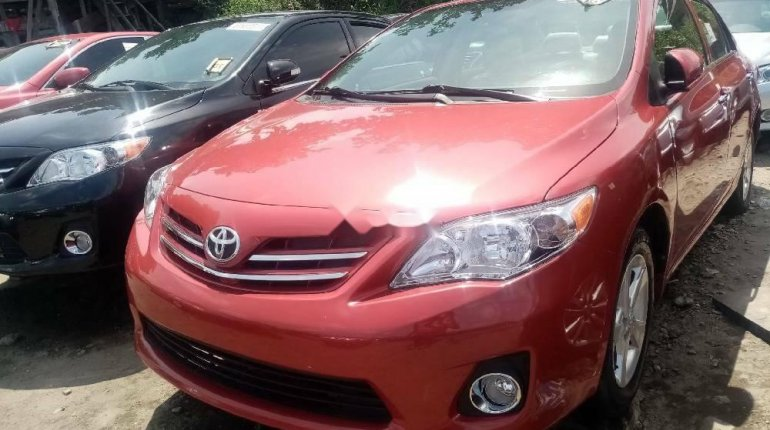 Foreign Used 2010 Red Toyota Corolla for sale in Lagos. -0