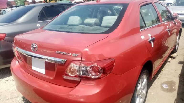 Foreign Used 2010 Red Toyota Corolla for sale in Lagos. -3