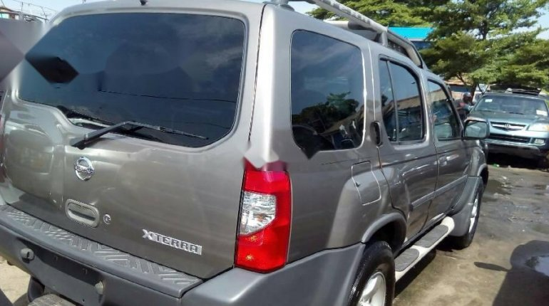 Very Clean Foreign Used Grey Nissan Xterra 2004 Model for sale in Lagos. -1